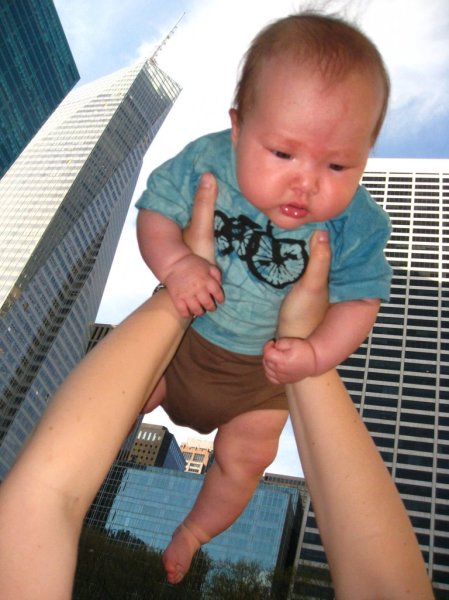 This photo was not photo-shopped.  Giant baby attacks midtown skyline!