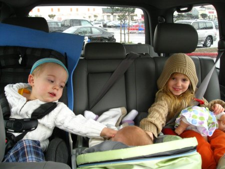 Even car trips are fun when you're with friends (note the mysterious case of the teleporting hat).