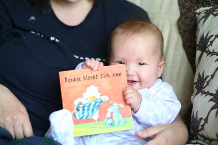 Talia is adjusting quite well.  As you can see here, she is already reading her new Dutch books (gifts thanks to an American couple we met at the playground last week who are on thier way back to Vermont).
